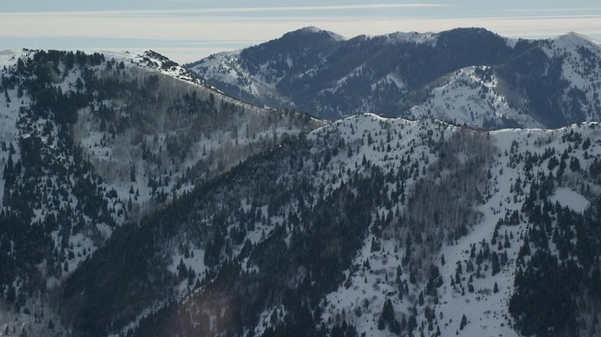 6K stock footage aerial video orbit Oquirrh Mountains ridge with light winter snowdrift, Utah Aerial Stock Footage   AX125_172