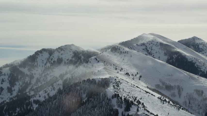6K stock footage aerial video of snowdrifts on peaks in the Oquirrh Mountains, Utah Aerial Stock Footage | AX125_183