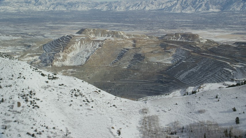 6K stock footage aerial video approach the Bingham Canyon Mine in winter, Utah Aerial Stock Footage | AX125_227