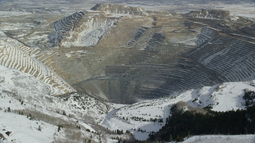 6K stock footage aerial video of approaching Bingham Canyon Mine with light winter snow, Utah Aerial Stock Footage | AX125_228