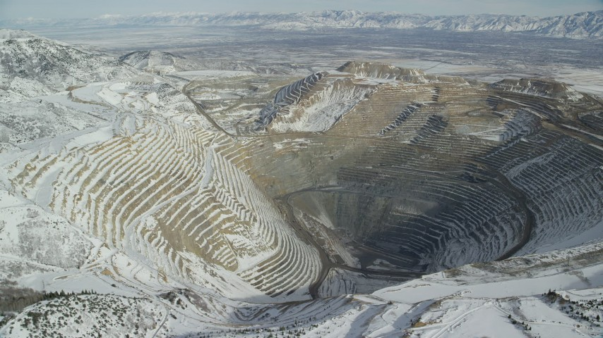 6K stock footage aerial video orbiting the Bingham Canyon Mine in winter with light snow in Utah Aerial Stock Footage AX125_229