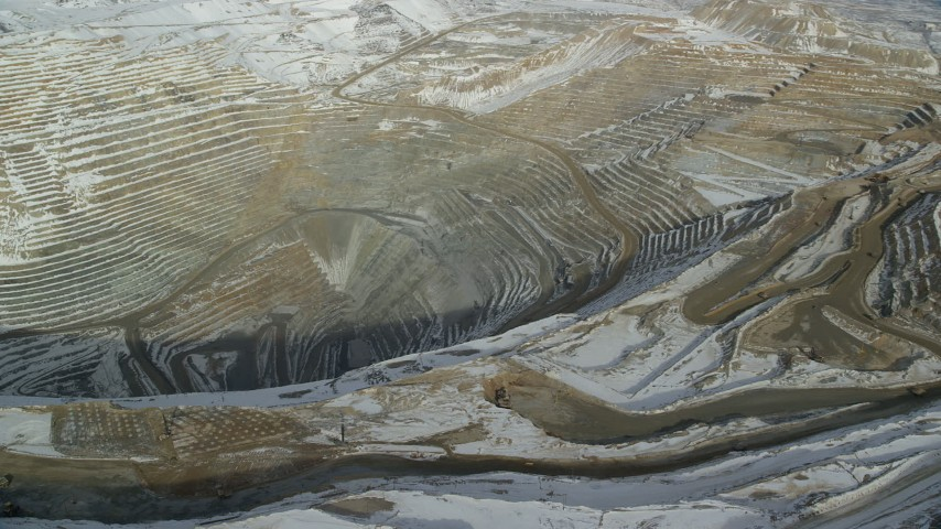 6K stock footage aerial video pan across the Bingham Canyon Mine with light winter snow in Utah Aerial Stock Footage | AX125_234