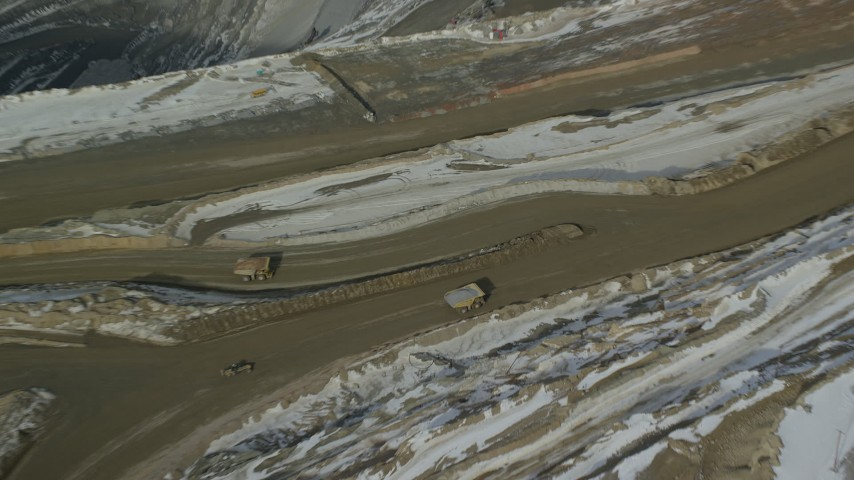 6K stock footage aerial video orbit above gravel hauler at Bingham Canyon Mine in winter, Utah Aerial Stock Footage | AX125_236