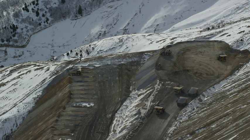 6K stock footage aerial video of gravel haulers working at the Bingham Canyon Mine in winter, Utah Aerial Stock Footage | AX125_249