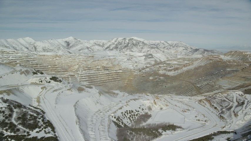 6K stock footage aerial video of Bingham Canyon Mine with winter snow in Utah Aerial Stock Footage | AX125_254