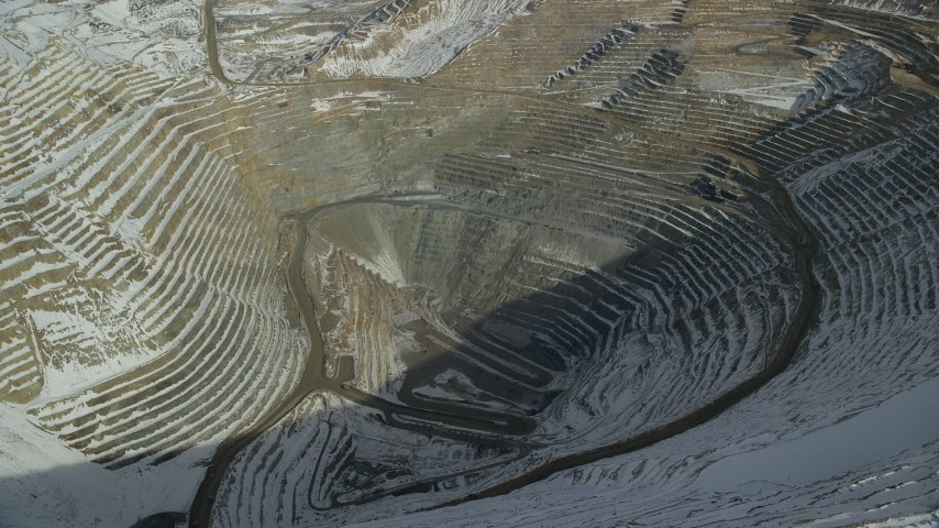 Orbit the Bingham Canyon Mine in Winter with a View to the Bottom Aerial Stock Footage | AX125_259