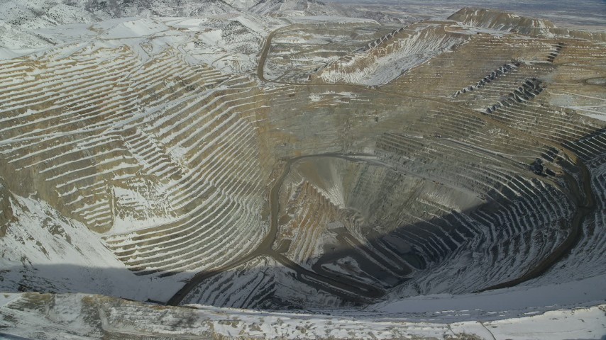 6K stock footage aerial video fly over deep open pit copper mine with winter snow, Bingham Canyon Mine, Utah Aerial Stock Footage | AX125_263