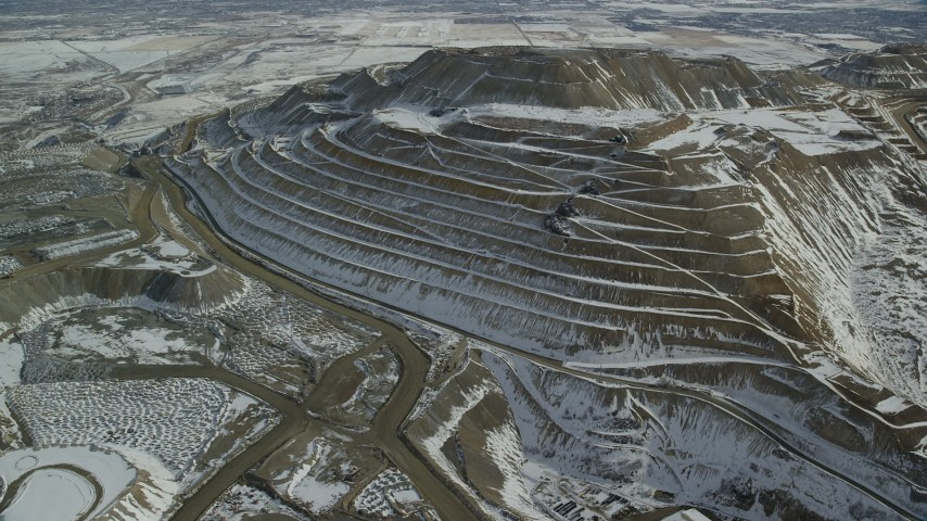6K stock footage aerial video of orbiting the side of the Bingham Canyon Copper Mine in winter, Utah Aerial Stock Footage | AX125_267
