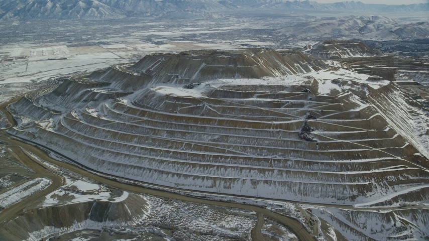6K stock footage aerial video of orbiting the side of the Bingham Canyon Mine with light winter snow, Utah Aerial Stock Footage | AX125_268