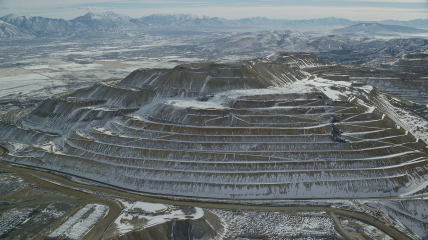6K stock footage aerial video of snow-dusted tiers of the Bingham Canyon Mine in winter, Utah Aerial Stock Footage | AX125_269