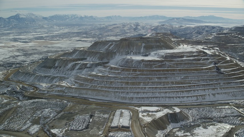 6K stock footage aerial video of tiered hill with winter snow at the Bingham Canyon Mine, Utah Aerial Stock Footage | AX125_270