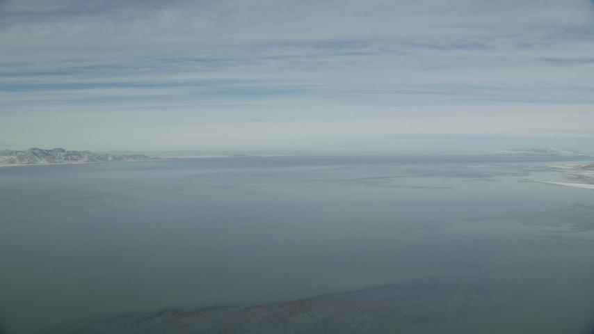 6K stock footage aerial video pan across the wide Great Salt Lake in winter, Utah Aerial Stock Footage | AX125_303