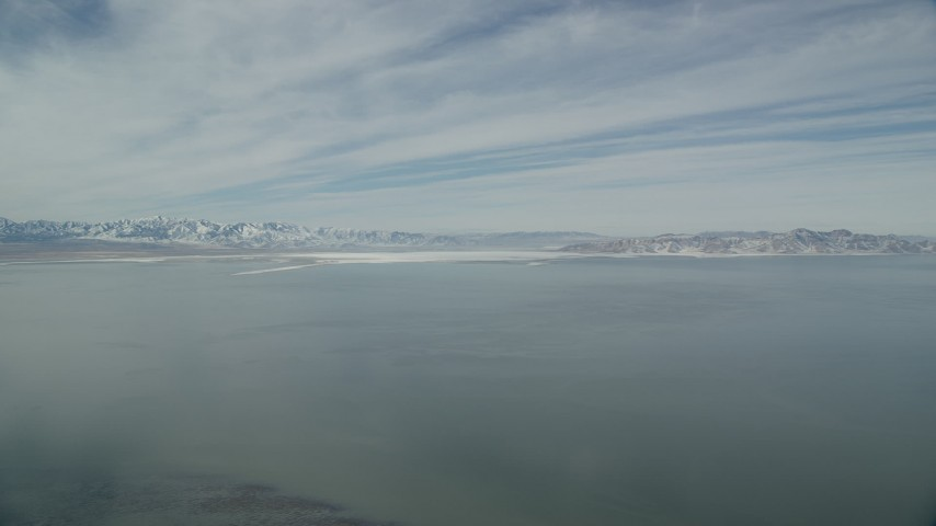 6K stock footage aerial video of snow mountains on the shore of the Great Salt Lake in Utah Aerial Stock Footage | AX125_306