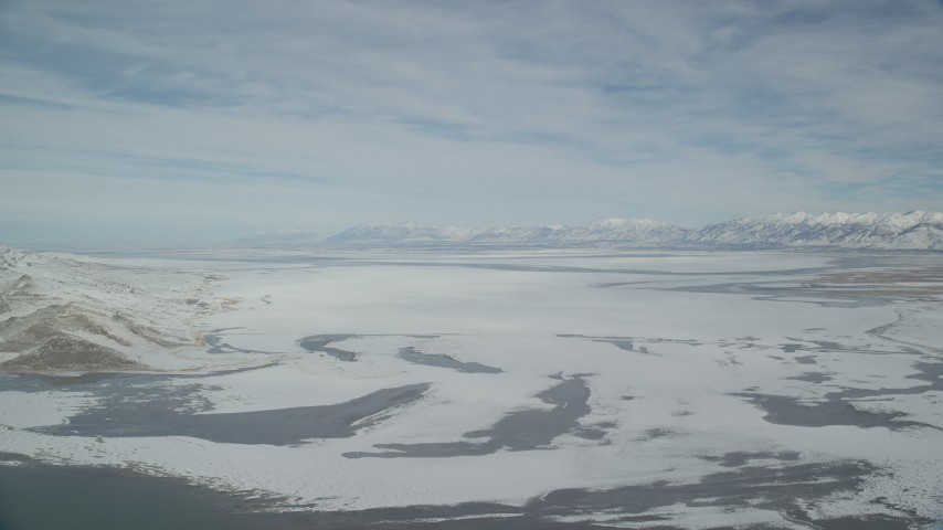 6K stock footage aerial video of snow covering Antelope Island in wintery Utah Aerial Stock Footage | AX125_310