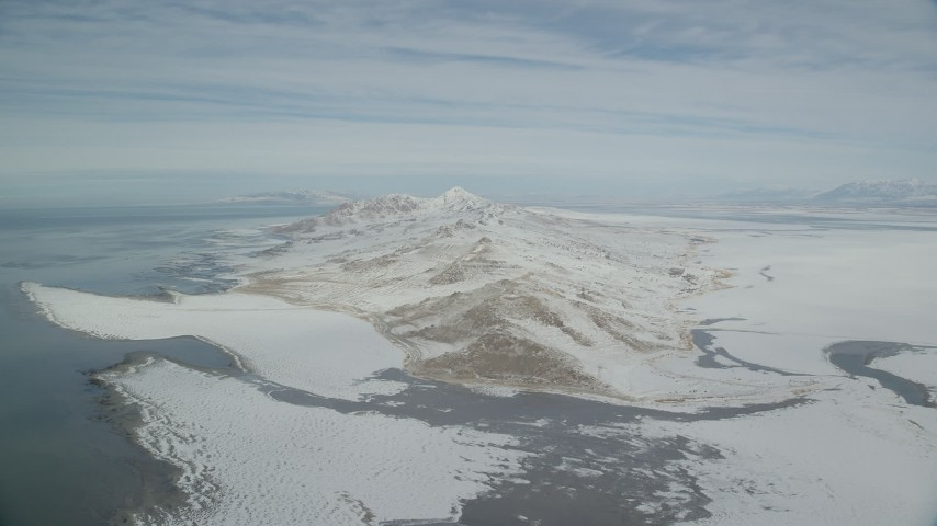 Slow Approach to Snow Mountains on Antelope Island, Utah Aerial Stock Footage | AX125_312