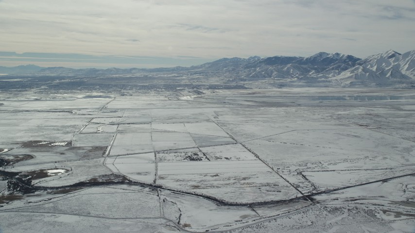 6K stock footage aerial video of the town of Magna and snowy Oquirrh Mountains in winter, Utah Aerial Stock Footage | AX125_319