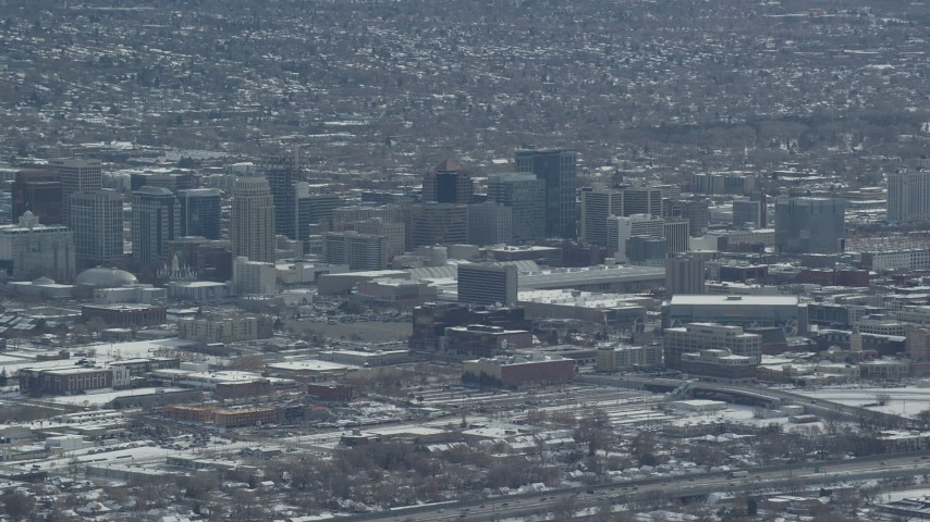6K stock footage aerial video of downtown buildings with winter snow in Downtown Salt Lake City, Utah Aerial Stock Footage | AX125_335