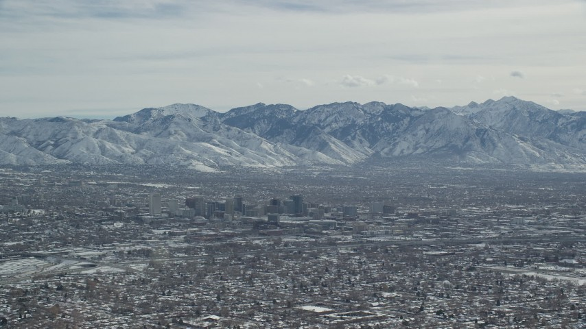 6K stock footage aerial video of Downtown Salt Lake City, Utah, with winter snow Aerial Stock Footage | AX125_336