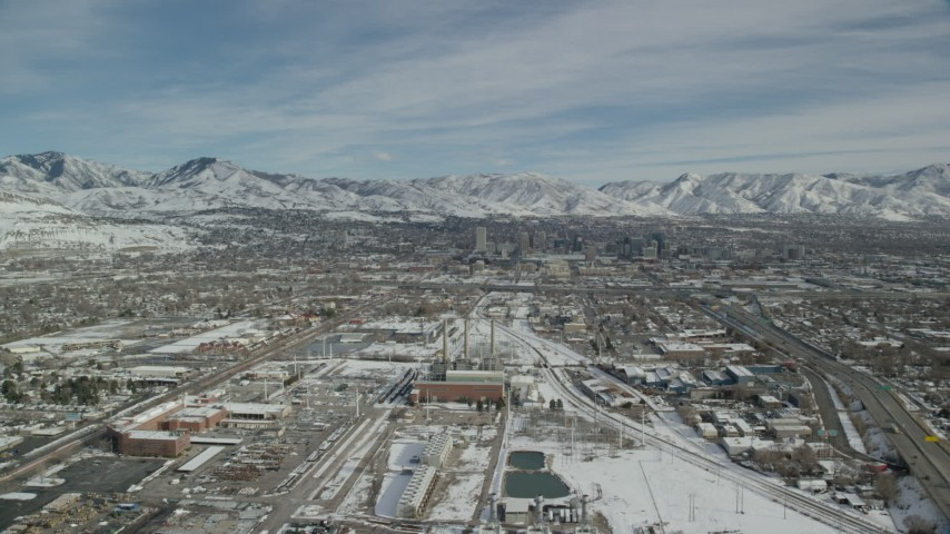 6K stock footage aerial video approach power plant and Downtown Salt Lake City with winter snow, Utah Aerial Stock Footage | AX126_006
