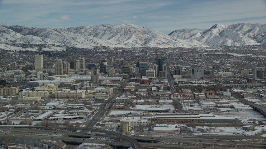 6K stock footage aerial video of the downtown area of Salt Lake City with winter snow in Utah Aerial Stock Footage | AX126_008