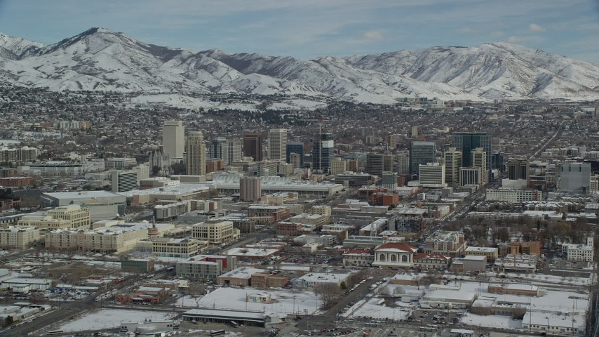 6K stock footage aerial video orbit of Downtown Salt Lake City with winter snow, Utah Aerial Stock Footage | AX126_009