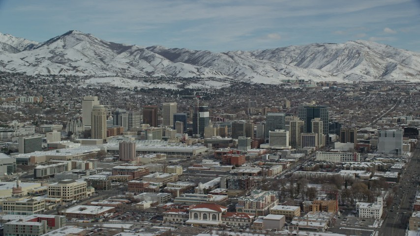 Flyby and then Approach Downtown Salt Lake City with Winter Snow Aerial Stock Footage | AX126_010