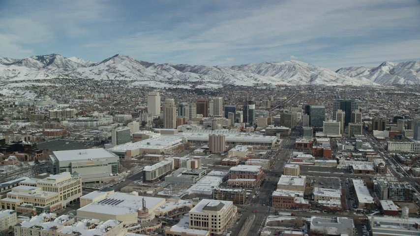 6K stock footage aerial video of orbiting Downtown Salt Lake City with snow on the ground in winter, Utah Aerial Stock Footage | AX126_011