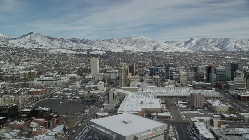 6K stock footage aerial video orbit of snowy Downtown Salt Lake City, Utah, in winter Aerial Stock Footage AX126_012