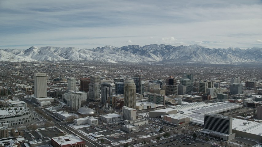 6K stock footage aerial video orbit of Downtown Salt Lake City buildings with light winter snow, Utah Aerial Stock Footage | AX126_013