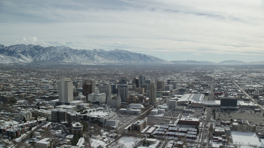 6K stock footage aerial video orbit Downtown Salt Lake City, Utah, with light winter snow Aerial Stock Footage | AX126_014