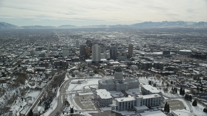 6K stock footage aerial video orbit of Utah State Capitol and Downtown Salt Lake City with snow in winter Aerial Stock Footage | AX126_017