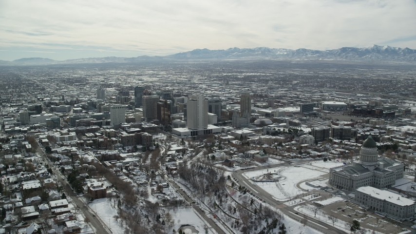 6K stock footage aerial video orbit Downtown Salt Lake City seen from Utah State Capitol with winter snow Aerial Stock Footage | AX126_018