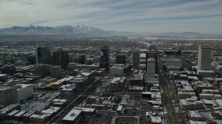 6K stock footage aerial video orbit city streets and buildings in Downtown Salt Lake City with winter snow, Utah Aerial Stock Footage | AX126_021