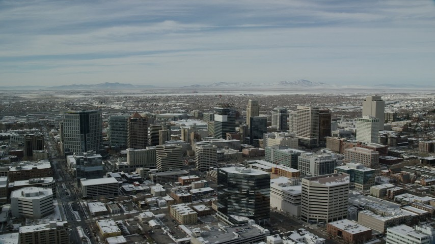 6K stock footage aerial video circle the downtown area of Salt Lake City with winter snow in Utah Aerial Stock Footage | AX126_023