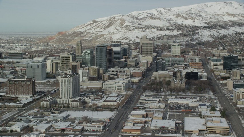 6K stock footage aerial video orbit south side of Downtown Salt Lake City with winter snow, Utah Aerial Stock Footage | AX126_024