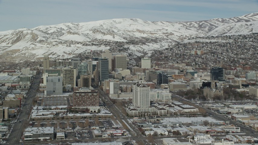 6K stock footage aerial video of southern side of Downtown Salt Lake City with winter snow, Utah Aerial Stock Footage | AX126_025