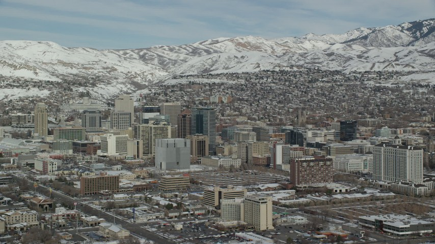 6K stock footage aerial video orbiting southwest side of Downtown Salt Lake City with winter snow, Utah Aerial Stock Footage | AX126_026