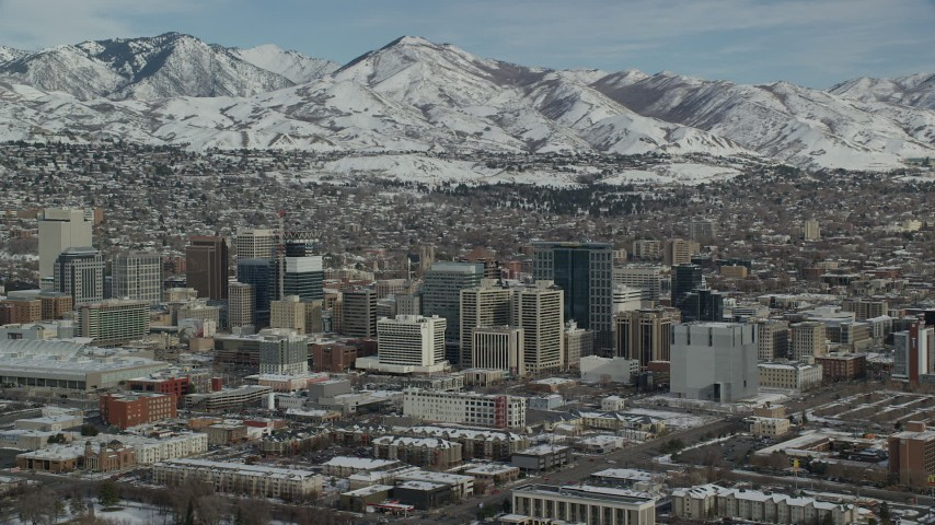 6K stock footage aerial video orbit west side of Downtown Salt Lake City with winter snow, Utah Aerial Stock Footage | AX126_028