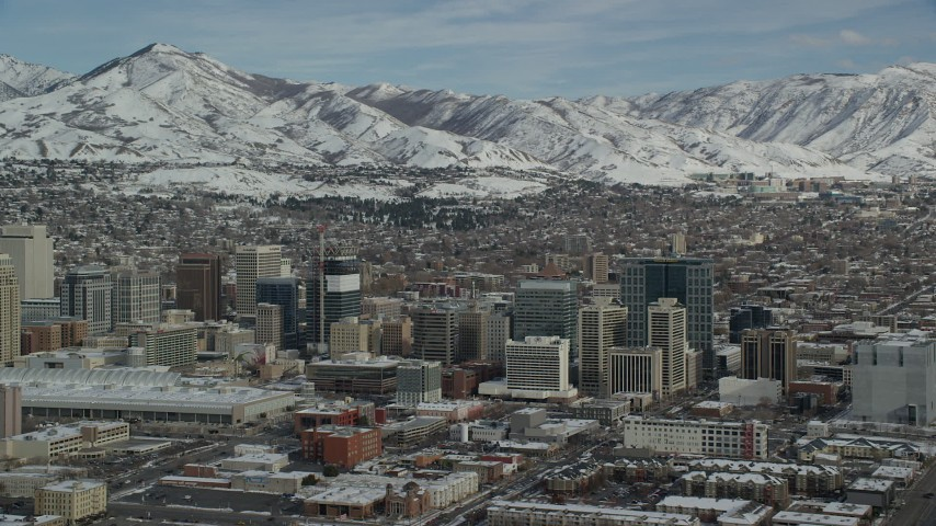 Orbit Downtown Salt Lake City and Convention Center with Winter Snow Aerial Stock Footage | AX126_029