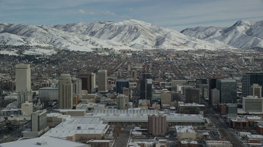 Circling West Side of Downtown Salt Lake City with Winter Snow Aerial Stock Footage | AX126_030