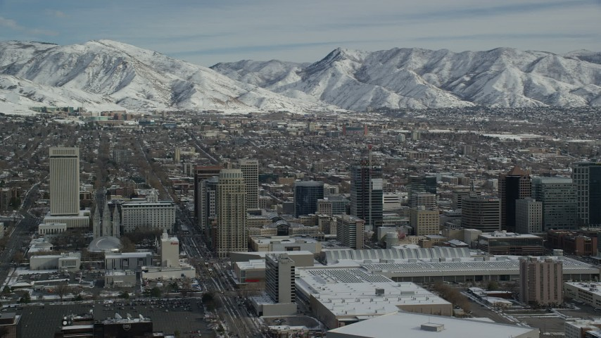 Orbit Convention Center and Downtown Salt Lake City Buildings with Winter Snow Aerial Stock Footage | AX126_031