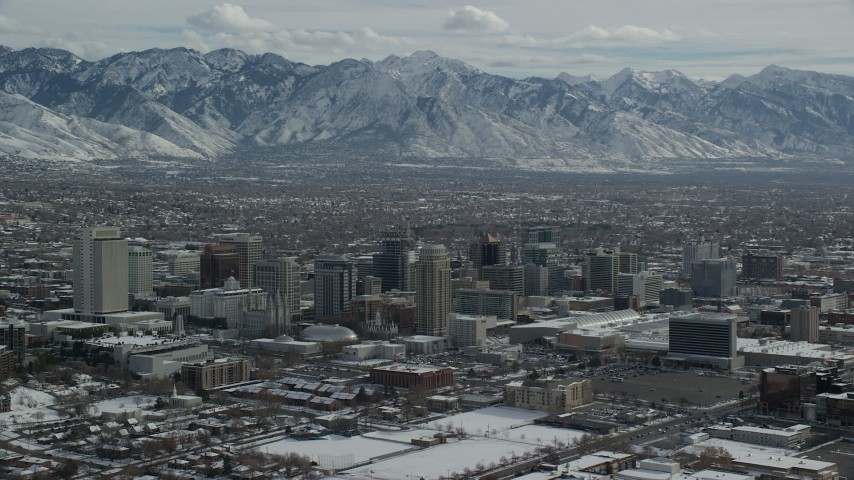 6K stock footage aerial video orbit of the northwest side of Salt Lake City's downtown with winter snow, Utah Aerial Stock Footage | AX126_033