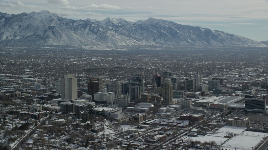 6K stock footage aerial video of an orbit of Downtown Salt Lake City with snowy mountains in background, Utah Aerial Stock Footage | AX126_034