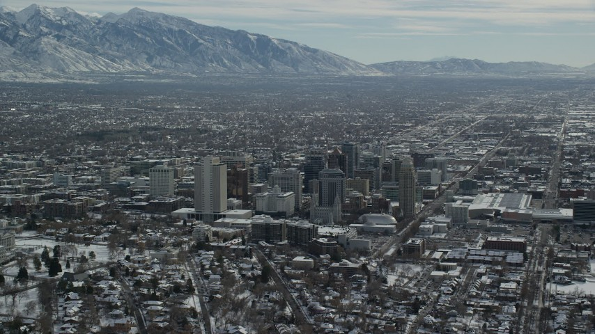 Orbit North Side of Downtown Salt Lake City with Snow in Winter Aerial Stock Footage | AX126_035
