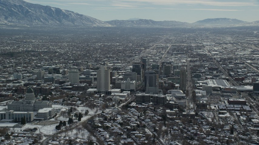 6K stock footage aerial video orbit the north side of Utah State Capitol and Downtown Salt Lake City in winter Aerial Stock Footage | AX126_036