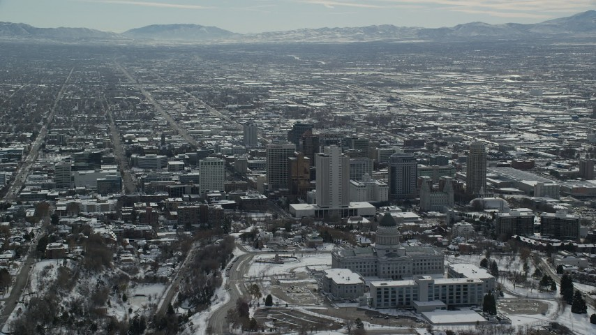 Orbit Northeast of Downtown Salt Lake City and Utah State Capitol in Wintertime Aerial Stock Footage | AX126_038