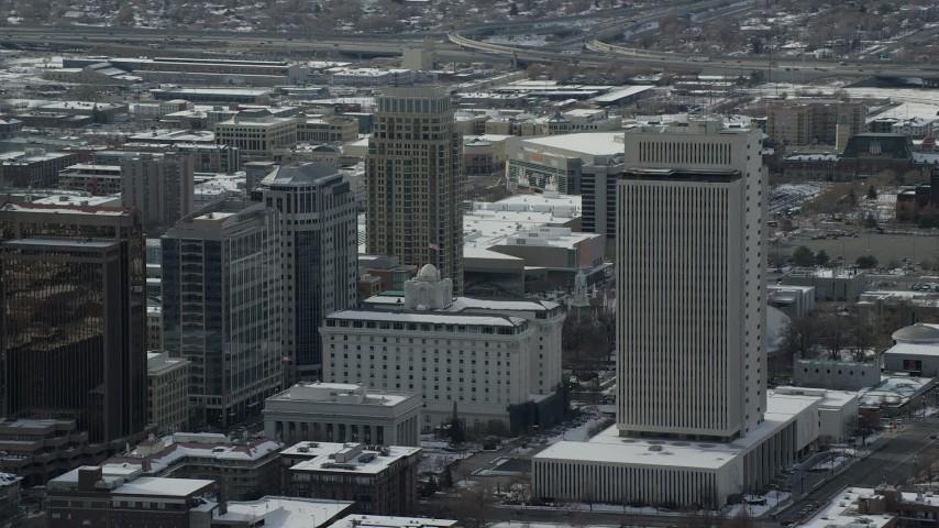 6K stock footage aerial video circle office buildings in Downtown Salt Lake City in winter, Utah Aerial Stock Footage | AX126_042