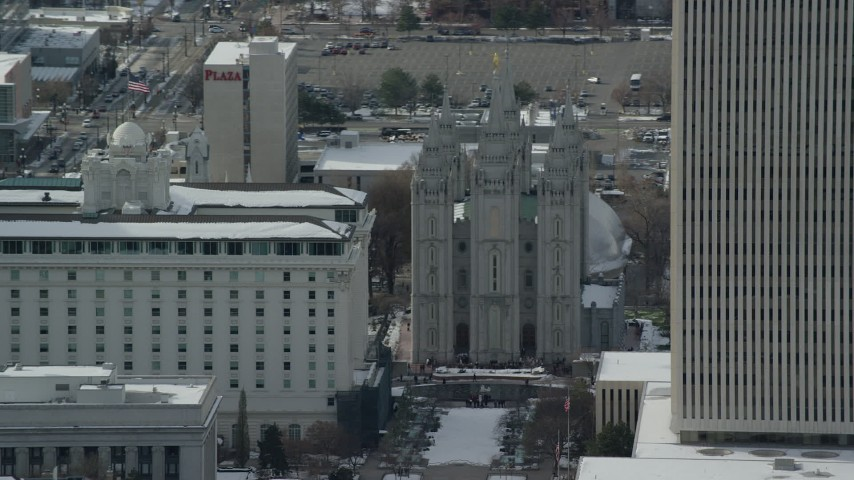 Orbit the Salt Lake Temple in Downtown with Winter Snow Aerial Stock Footage | AX126_043