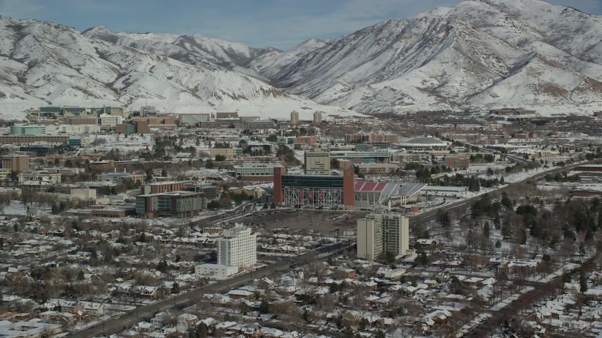 6K stock footage aerial video orbit University of Utah campus near Rice-Eccles Stadium with winter snow, Salt Lake City, Utah Aerial Stock Footage | AX126_046