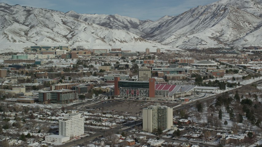 6K stock footage aerial video approach Rice-Eccles football stadium on the campus of University of Utah in winter, Salt Lake City Aerial Stock Footage | AX126_047